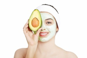 4587549-young-woman-with-a-smile-holding-with-avocado